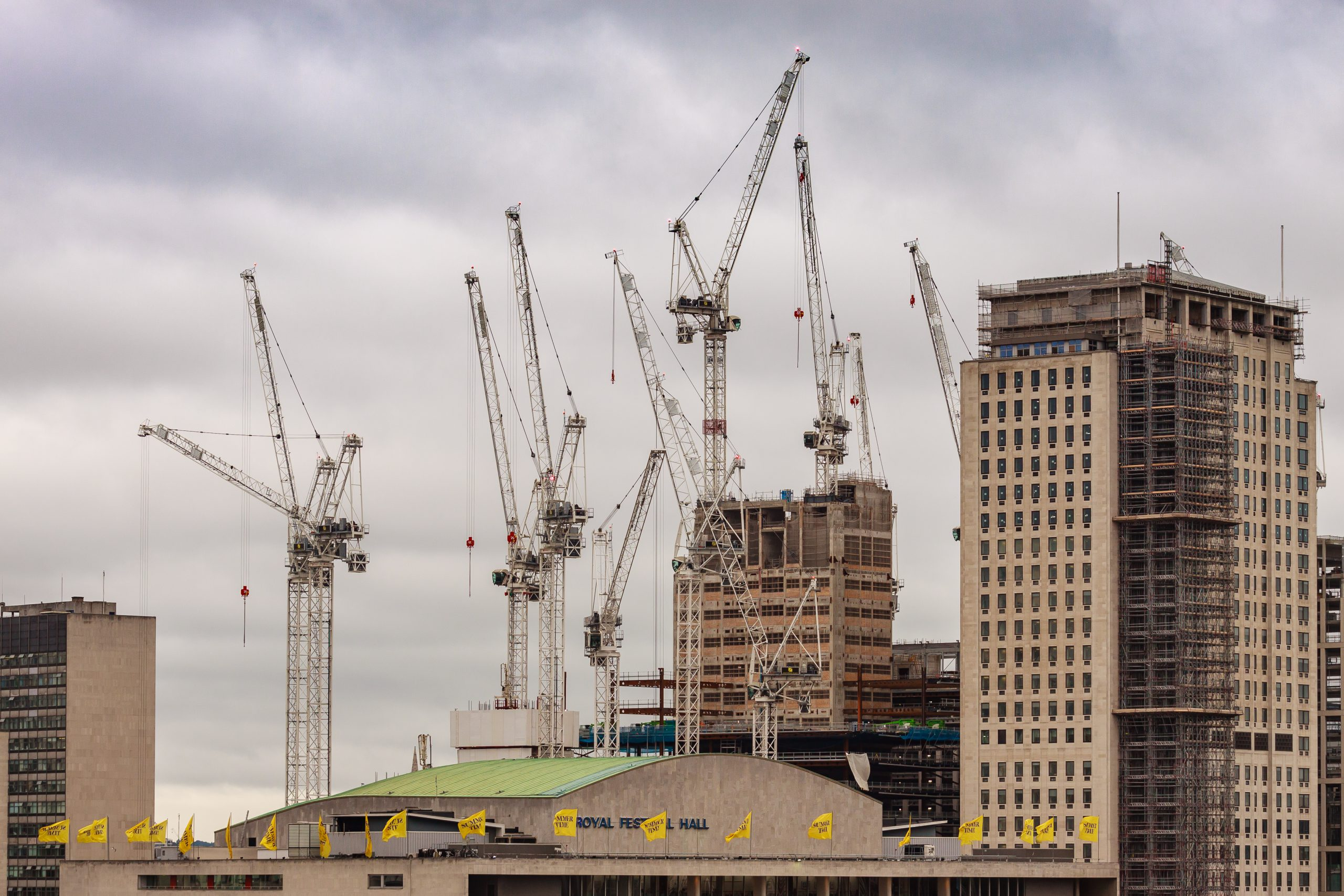 Picture of cranes and commercial skyscraper