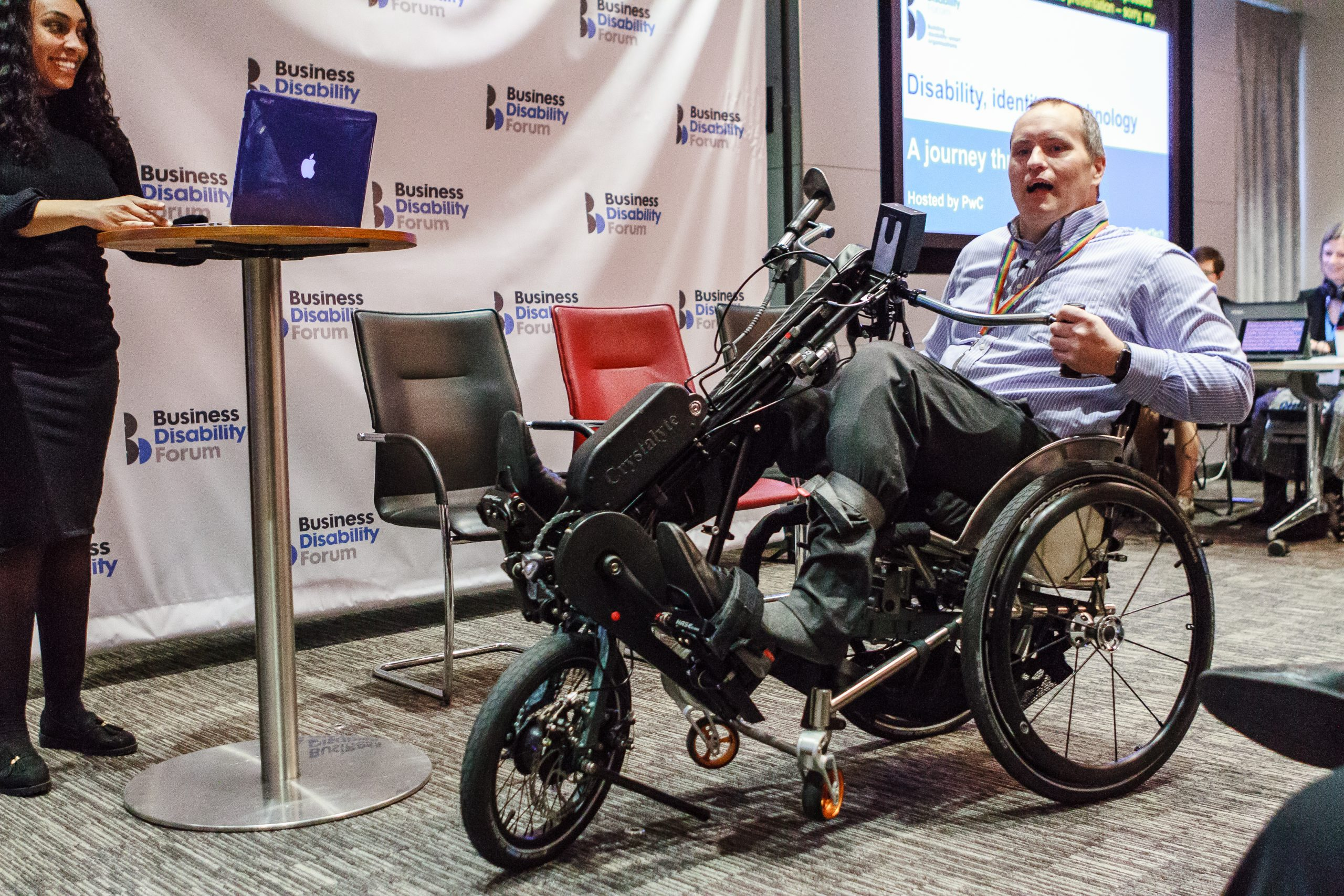 James Hallam, Controls Assurance at PwC, making an entrance on his electric-assisted handcycle at the event