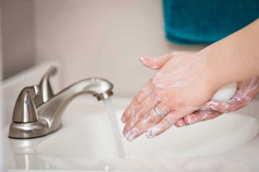 Image of person washing hands