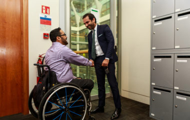 Image of a man in a wheelchair shaking hands