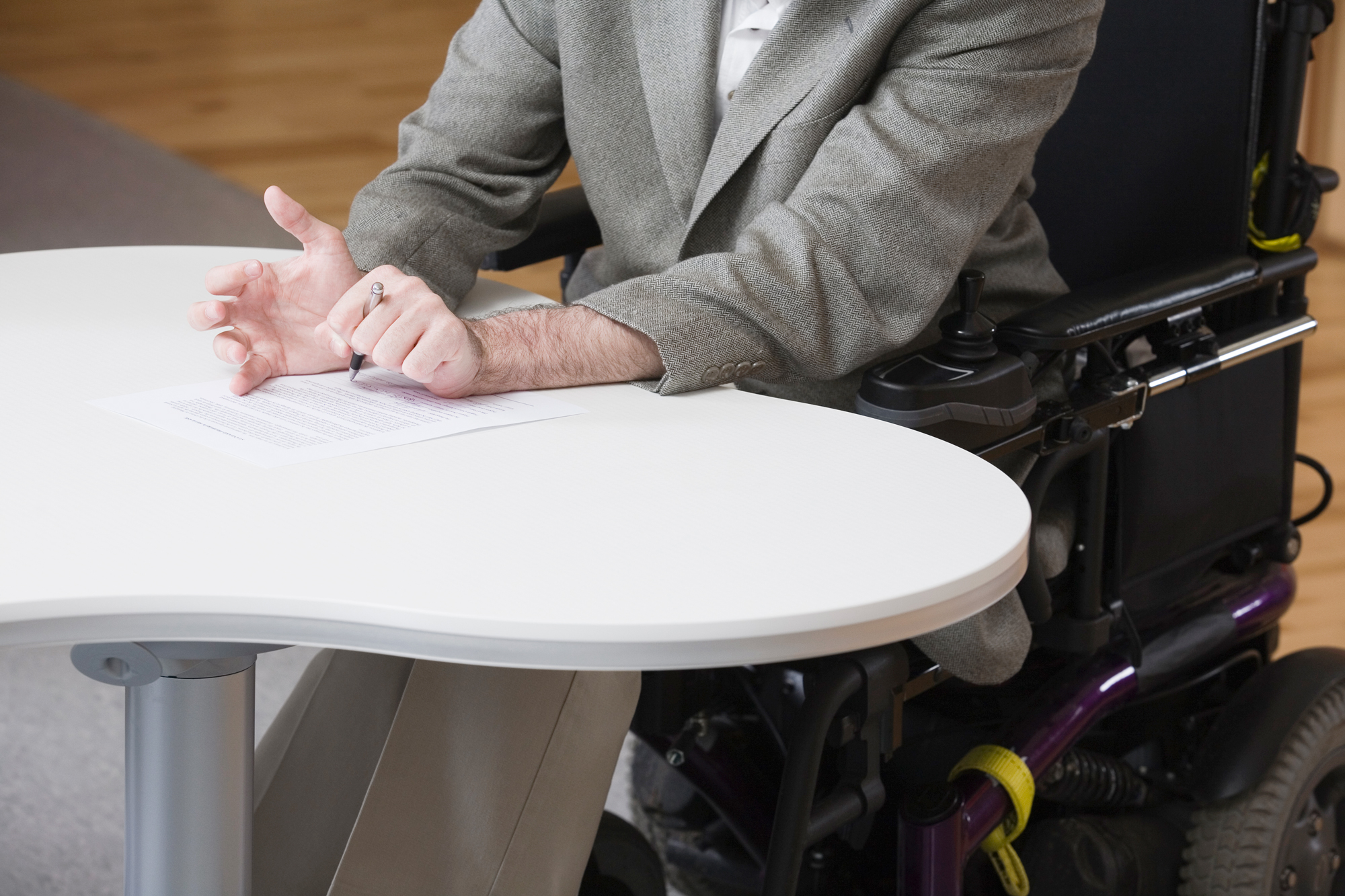 Image of wheelchair user at a table