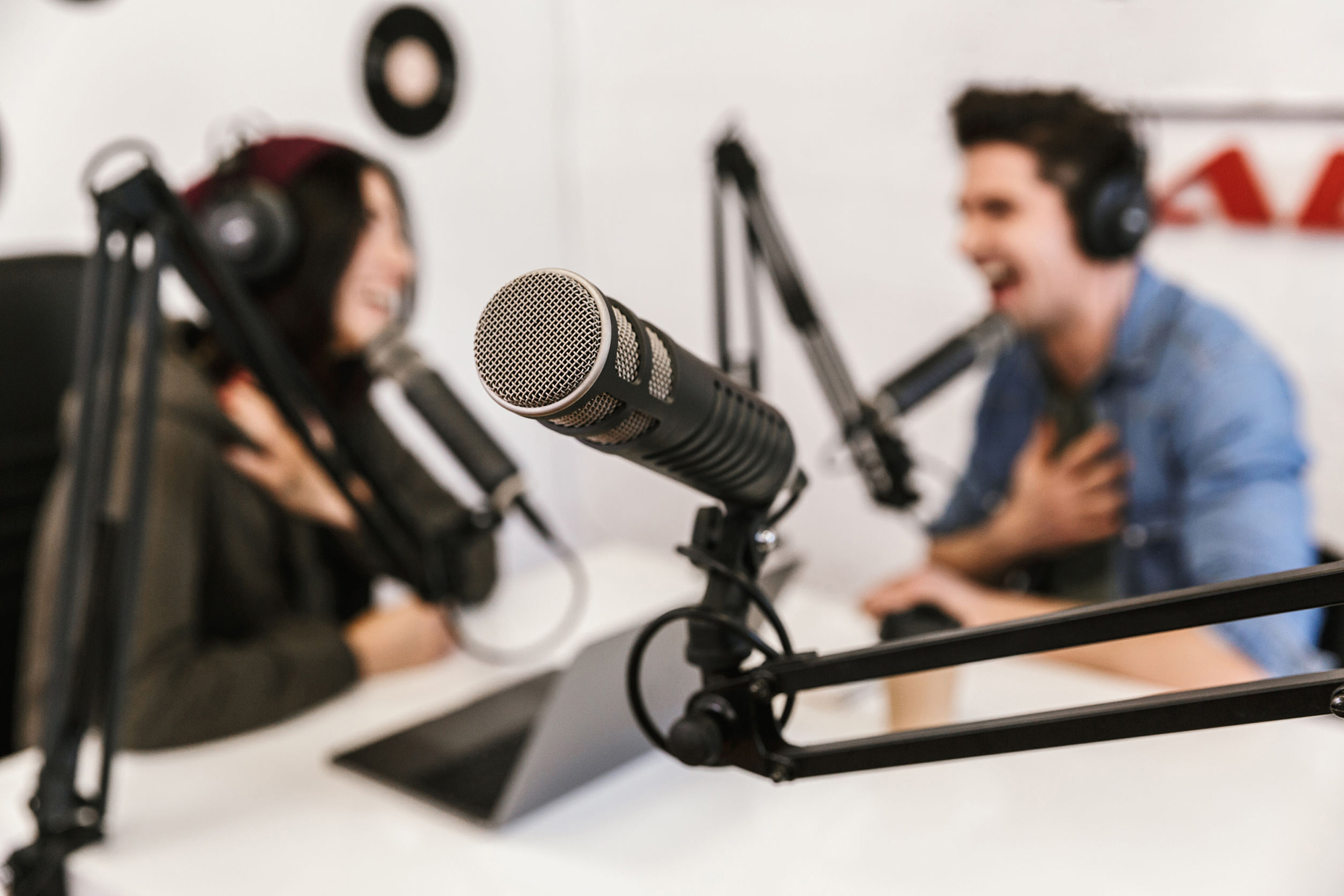 Image of two people recording a podcast
