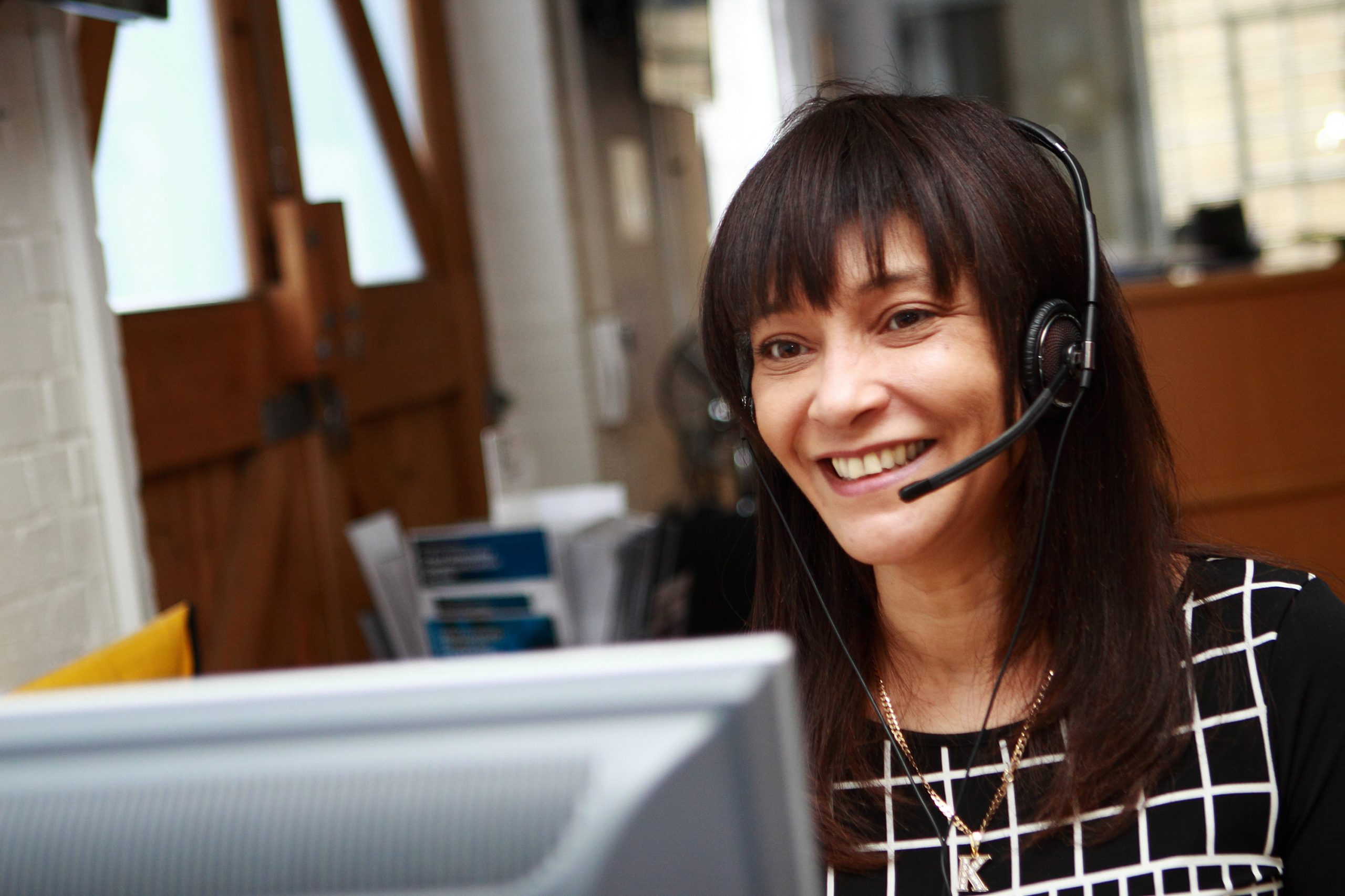 Image of woman using headset