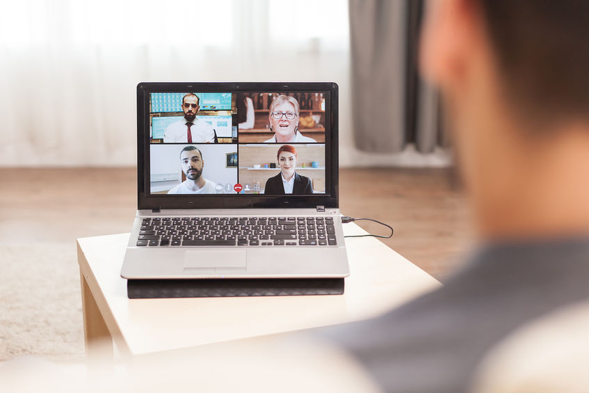 Businessman in a video conference with his team while working from home during quarantine.