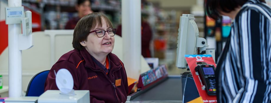 Cashier and female customer in conversation