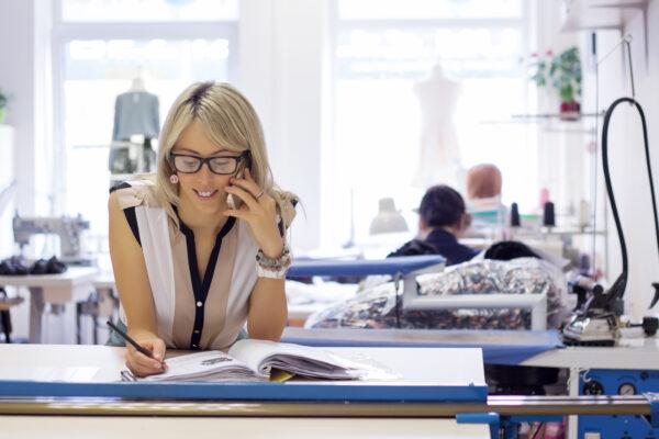 Woman taking customer orders by phone